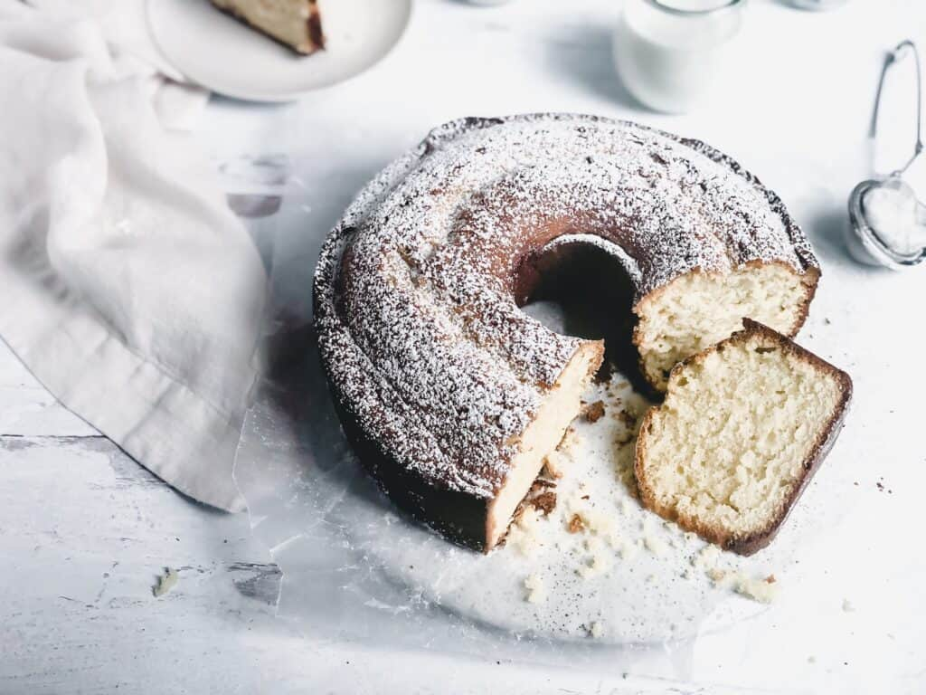 pound cake sliced in half on white surface