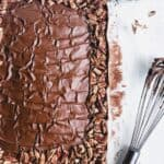 chocolate sheet cake with chocolate frosting on parchment paper