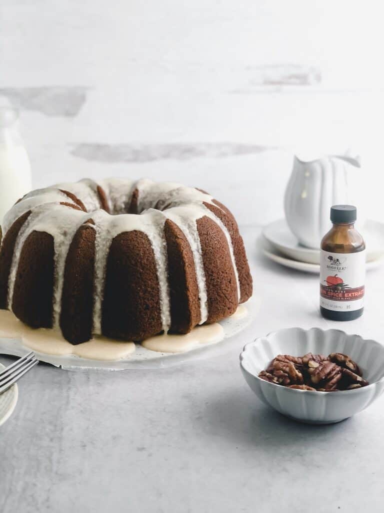 close up side view of Pumpkin Spice Bundt Cake with Maple Glaze on wax paper